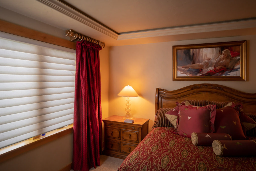 red silk drapery panel in master bedroom