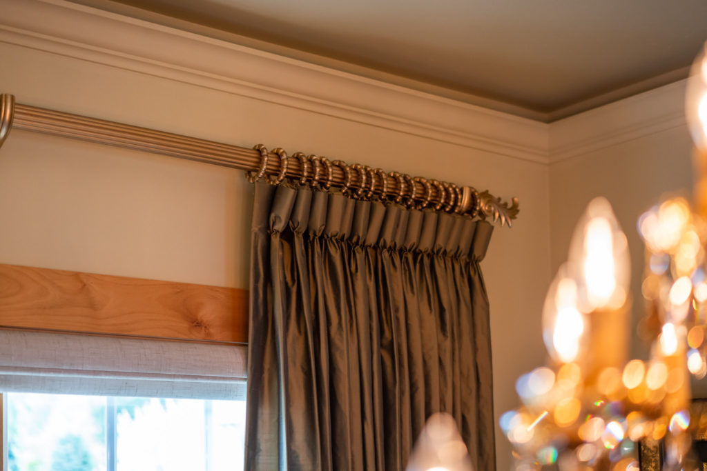 bronze colored silk drapery with goblet pleats on gold wood rod