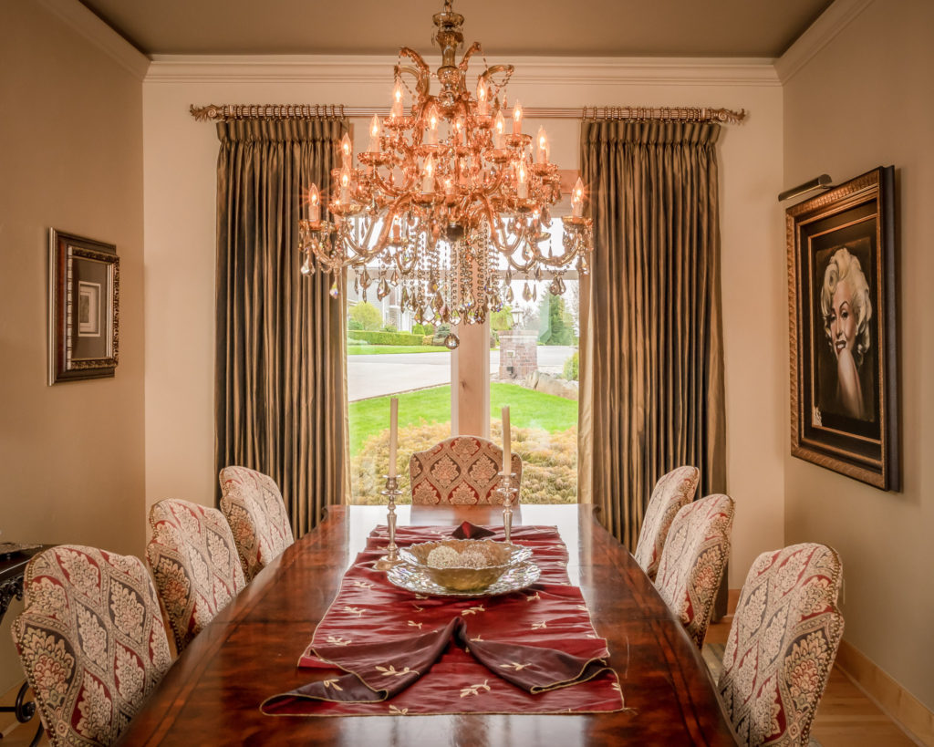 dining room table, chandelier, gold draperies