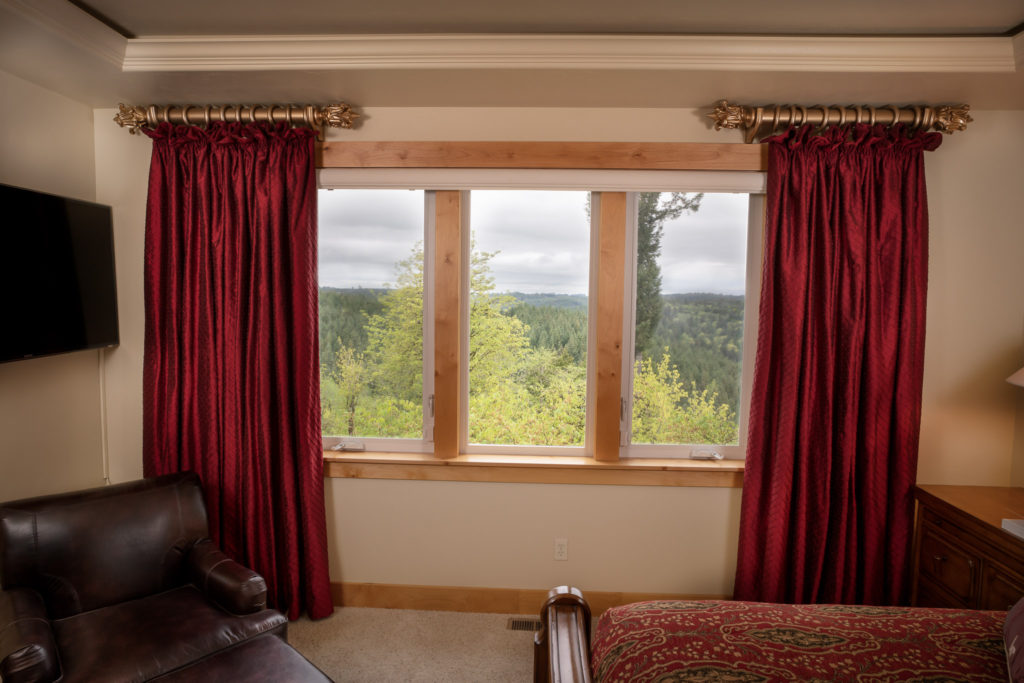 red silk drapery framing window in bedroom